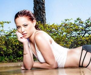 Stunning redhead babe Megan Medellin posing in underwear outdoor