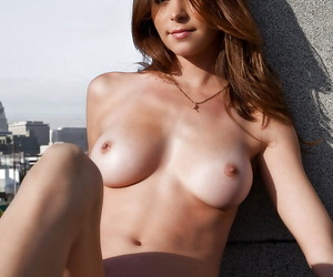 Adorable babe Amber Sym slipping off her lingerie outdoor