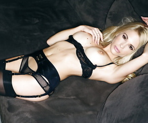 Busty hottie in stockings Dani Mathers gets rid of her lacy lingerie