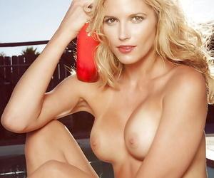 Pretty blonde babe Liz Betzen stripping off her bikini by the pool