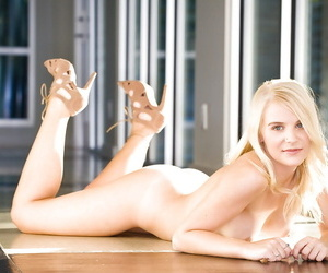Voluptuous blonde coed Abigale Alayne stripping off her dress and panties