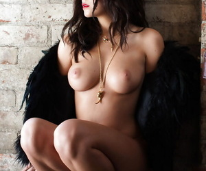 Beautiful centerfold babe Alexandra Tyler posing in hat and furs