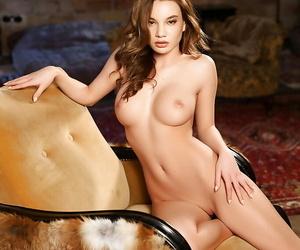 Centerfold model Clara releasing nice tits from black lingerie
