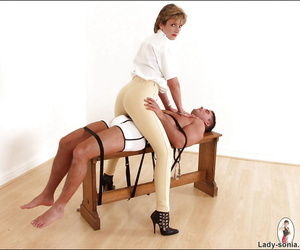 Quite clothed femdom superior to before cavalier heels has some fun not far from her male pet