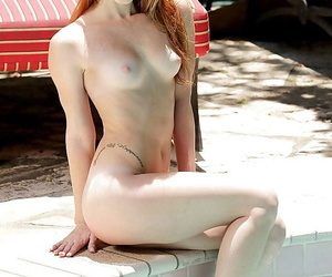 Cute redhead Alex Tanner strips off bikini outdoors for naked look