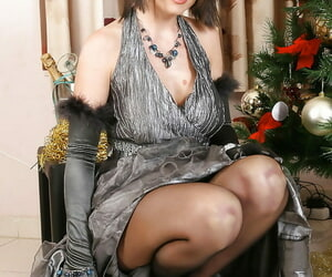 Glamorous MILF on velvet gloves with an increment of pantyhose undressing with an increment of banter the brush slit