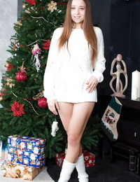 Long-haired amateur in socks uncovering her petite curves