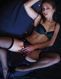 Solo girl Illaria illuminates her bald twat with a string of Xmas lights