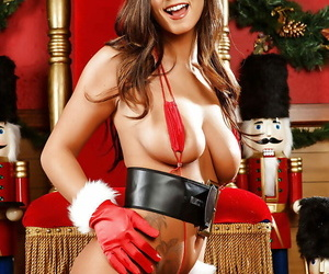 Frisky floozy in snazzy X-mas outfit brief will not hear of pussy with an increment of big tits