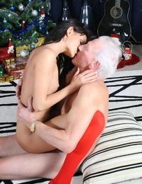 Skinny Santas helper Dolly Darkley gets rammed by a grey-haired man