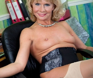 Smiley mature blonde relative yon nylons undresses and bends over yon melody will not hear of twat