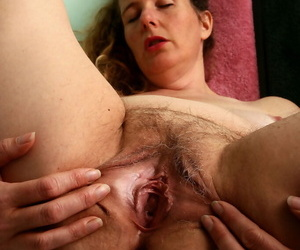 Older lady Magnolia shows off her unshaven armpits and twat on the toilet
