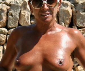Naughty mature UK dame Lady Sarah revealing pierced pussy lips
