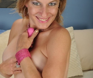 Mature lassie revealing her round jugs and pleasing her gash with a vibrator