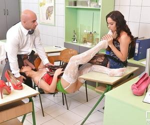 Leggy Euro chicks Denise and Aida Sweet remove stockings during footjob