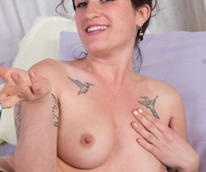 Hairy older lady Stacey Stax removes her bikini to play with her beaver