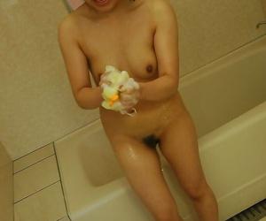 Seductive asian MILF Nagisa Takatsu has some fun taking bath