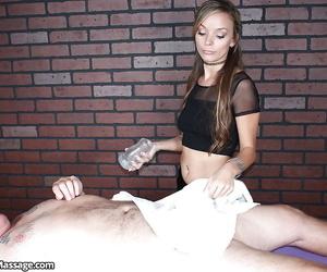 Skinny blonde girl in black hot pants jerks cock with masturbation aid