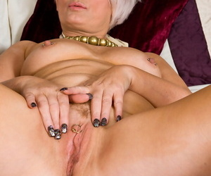 Ancient mature Foray T reveals small confidential with the addition of spreading all over show pierced pussy