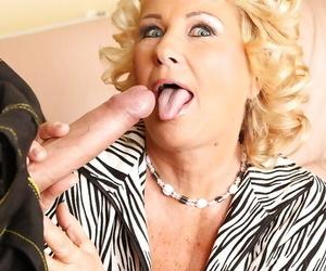 Older blonde lady Regi giving blowjob to big penis and taking cumshot