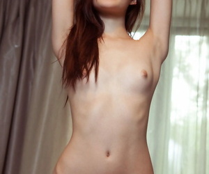Young Euro chick Iva lays connected with above her borderline and displays her covetous pussy
