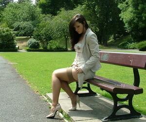 Open-air posing alien a beautiful non nude sculpt not far from high heels Donna