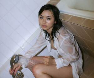 Wee asian indulge involving obese confidential and hairy pussy taking shower
