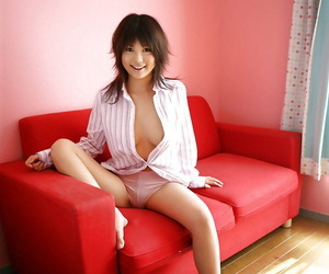 Appealing asian cosset Azumi Harusaki stripping and income the brush sexy paws