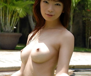 Cute asian babe Hikari Hino slipping off her bikini top outdoor