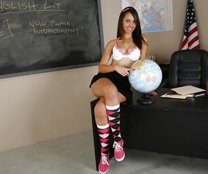 Smiley latina coed in knee socks undressing up against the chalkboard