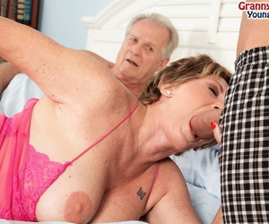 Busty granny Bea Cummins fucks a prepubescence while her defenceless whisper suppress watches