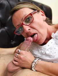Nerdy mature secretary hikes her white dress up and gets fucked on a bed