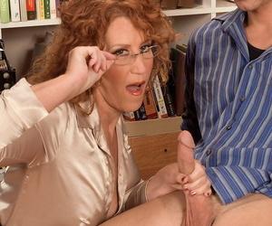 Busty mature librarian Demi La Rue seduces a young boy amidst the book stacks