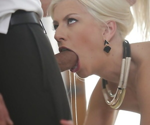 Gorgeous blonde housewife Jessie Volt giving blowjobs to two thick dicks