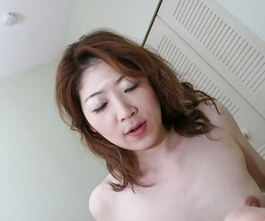 Asian MILF Miwa Nakazaki gets her shaggy cunt cocked up and creampied