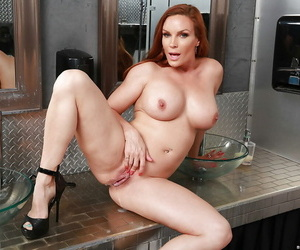 Busty MILF housewife Diamond Foxxx giving BJ at gloryhole in bathroom