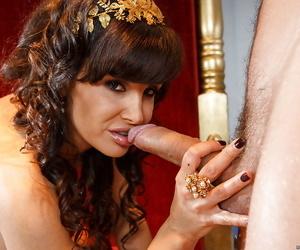 Sweet mature brunette Lisa Ann has her feet teased an suck hard cock