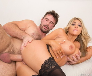 Big boobed blonde Kayla Kayden bangs a large uncut cock in sexy stockings
