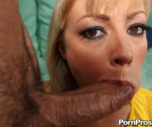 Sexy blonde MILF Adrianna Nicole deepthroating a large cock