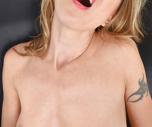 Tattooed older Euro woman Alina Long masturbating shaved cunt with sex toy