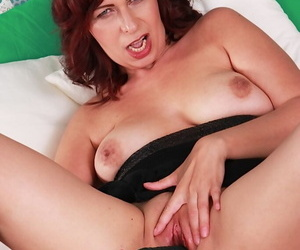 Mature French lady Laila Fereschte toying and masturbating shaved cunt