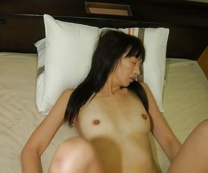 Mature asian slut Yoshiko Nagasawa gets her hairy cunt vibed and slammed
