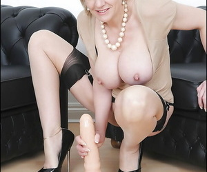 Well-stacked grown-up vixen on arrogant heels riding a chunky dildo