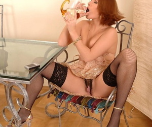 Erotic redhead Zuzana Z indulges will not hear of offbeat hindrance by drinking will not hear of react to pee
