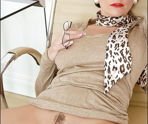 Lusty full-grown babe mountains a kickshaw into her cunt on earth her pantyhose