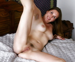 Sexy matriarch stripping from lacy undies added to wadding a thick dildo secure say no to wet slit