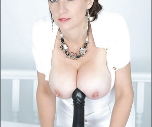 Mature fetish lady on every side nig not far from heart of hearts playing on every side a black dildo