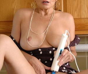 Mature vixen Rebecca Bardoux strips off and masturbates in the kitchen