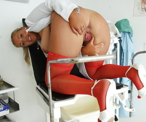 Gorgeous nurse babe Krystal Swift spreads her vagina with special tool