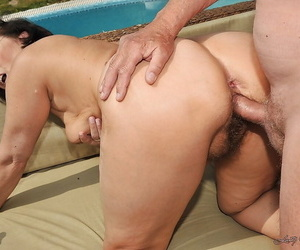 Filthy mature brunette with ample ass gets banged by two guys outdoor